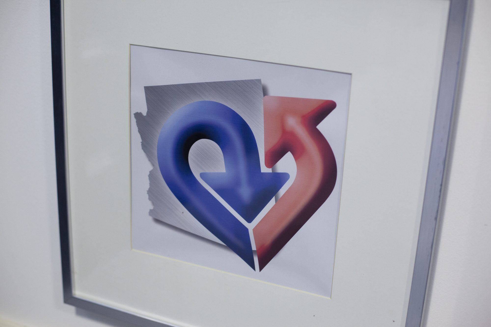 Arizona Heart Foundation Logo With Blue And Red Heart And Picture of Arizona In Background
