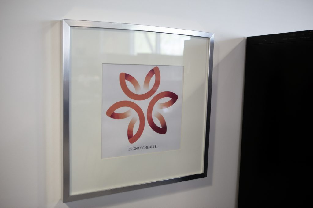 Dignity Health logo framed in Banahan office